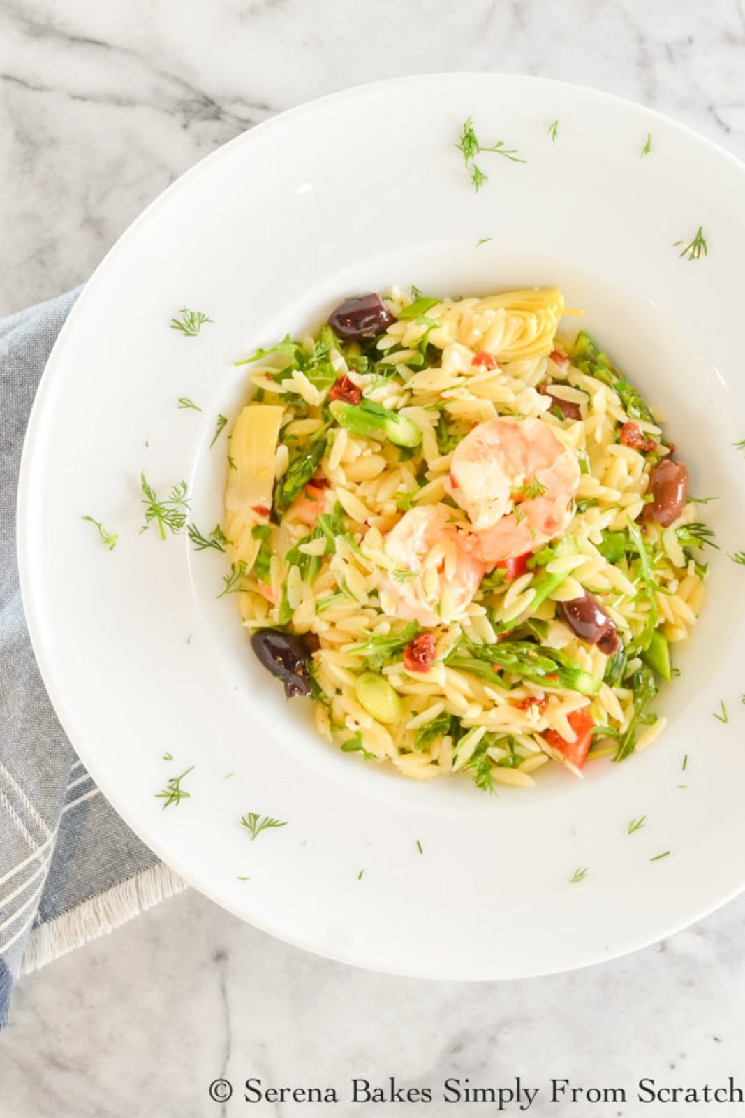 Shrimp Orzo Pasta Salad is delicious served warm or cold with roasted shrimp, asparagus, artichoke hearts, and lots of other goodies makes this a favorite from Serena Bakes Simply From Scratch.