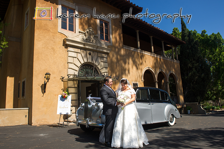 The Bride and the groom in front of the Villa Del Sol D'Oro with the vintage Rolls Royce