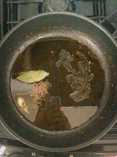 Making matar paneer step 4 oil, cumin seeds and bay leaf in hot pan