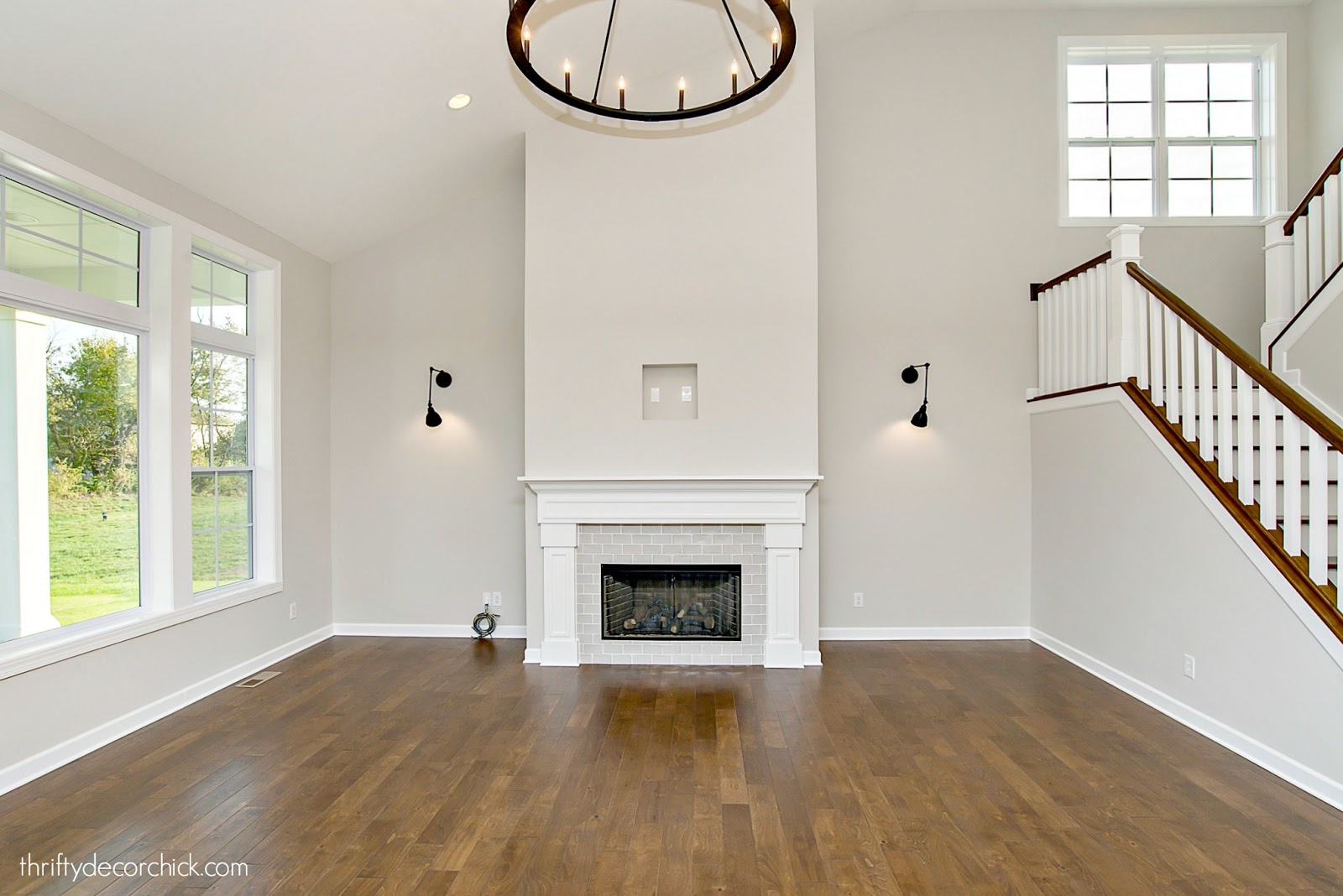 Two story fireplace in family room open stairs
