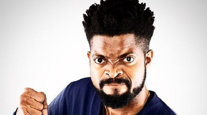 Comedian Basketmouth  knighted by the Queen of England
