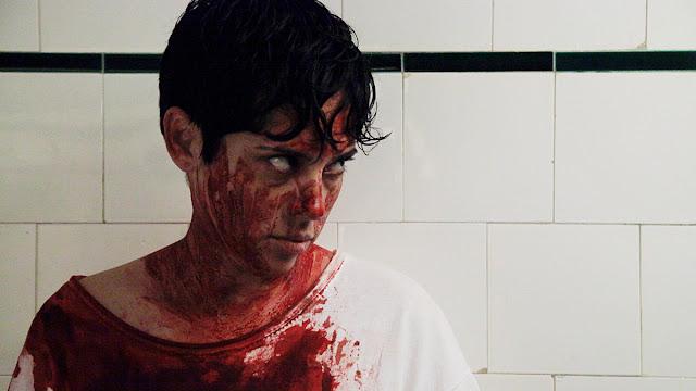 bloody woman in a bathroom