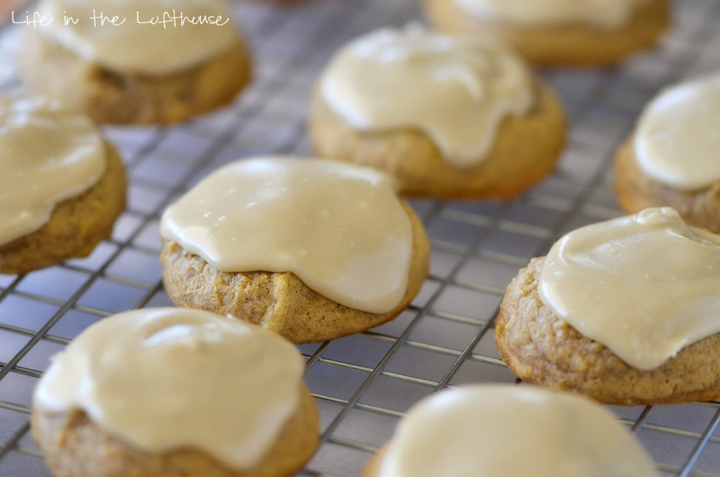 Pumpkin Cookies with Caramel Frosting! Soft cookies with pumpkin and warm spices topped with easy caramel frosting from A guest post from Life in the Lofthouse.