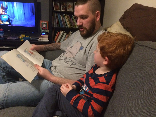 Little boy and his Daddy reading a book