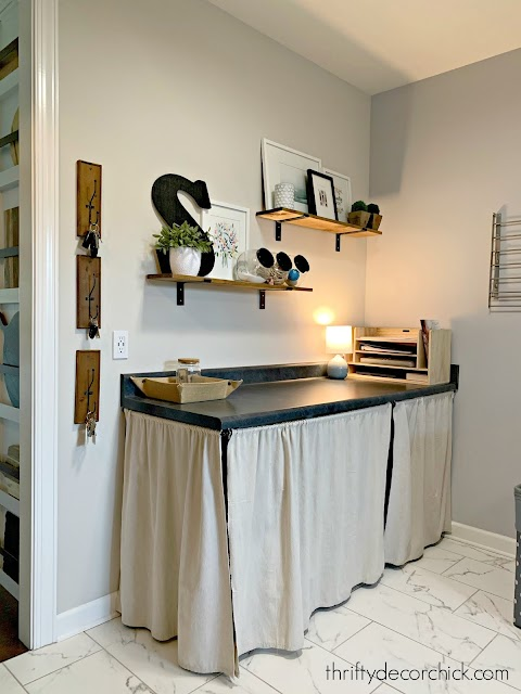 folding table laundry room with shelves