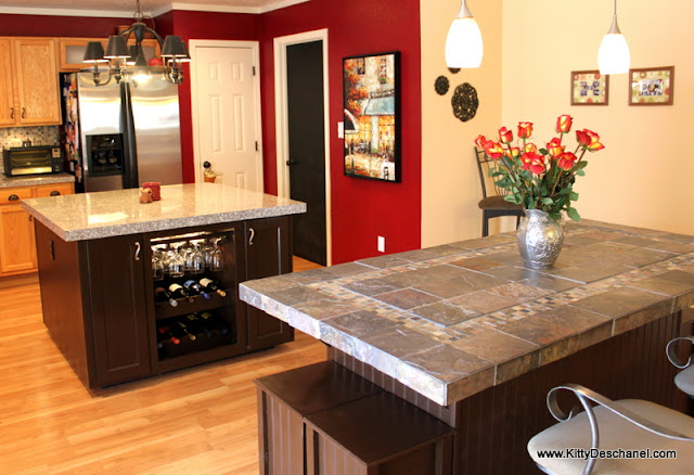 red kitchen with granite and slate countertops