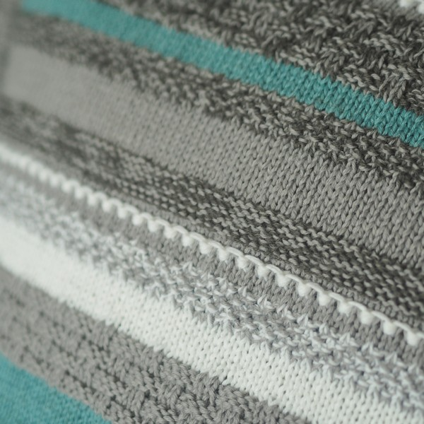 texture detail of grey and blue knitted cushion