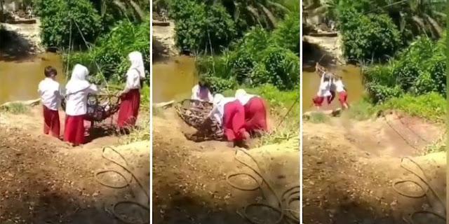 Viral, Siswa SD Bertaruh Nyawa ke Sekolah, Gelantungan di Keranjang Gantung Lewati Sungai