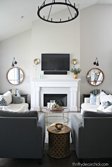 How to decorate tall fireplace wall