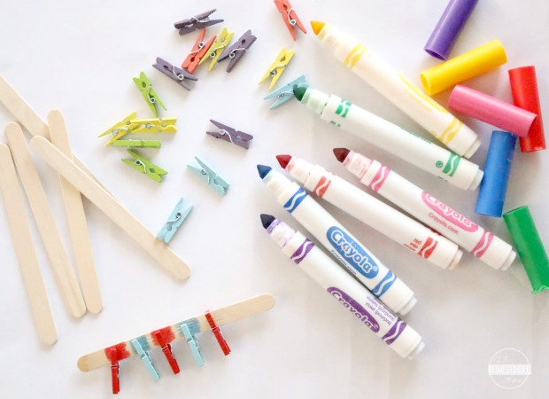 clothespins, markers, and colored craft clothespins