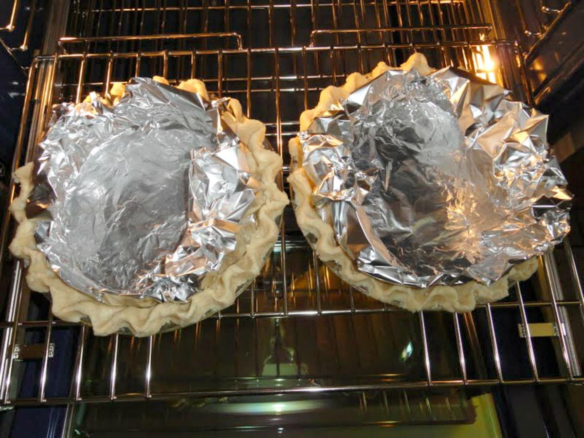Lined Flaky Pie Crusts in an oven.