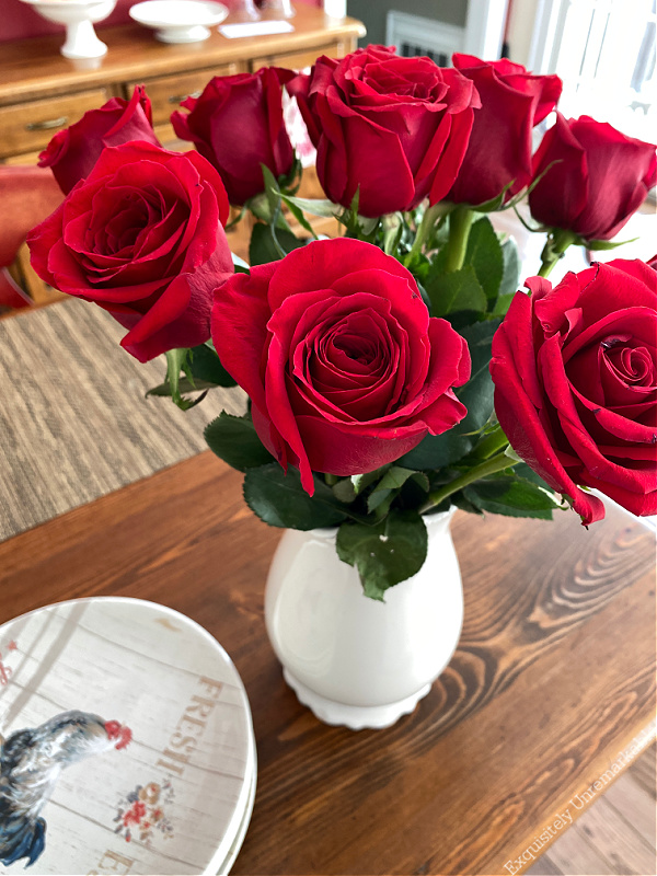 Farmhouse plates and red roses