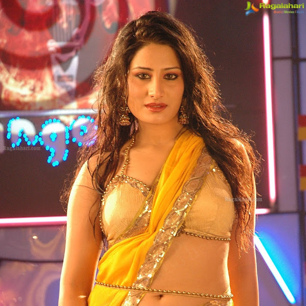 Ajju hot navel and cleavage show photos in saree from item song stills