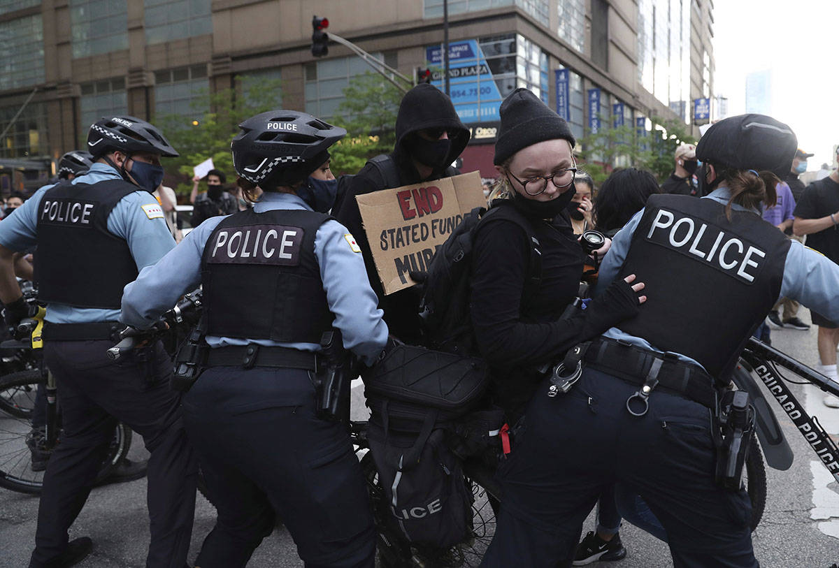 100 arrested, 13 police officer harmed after Chicago crowds encounter police