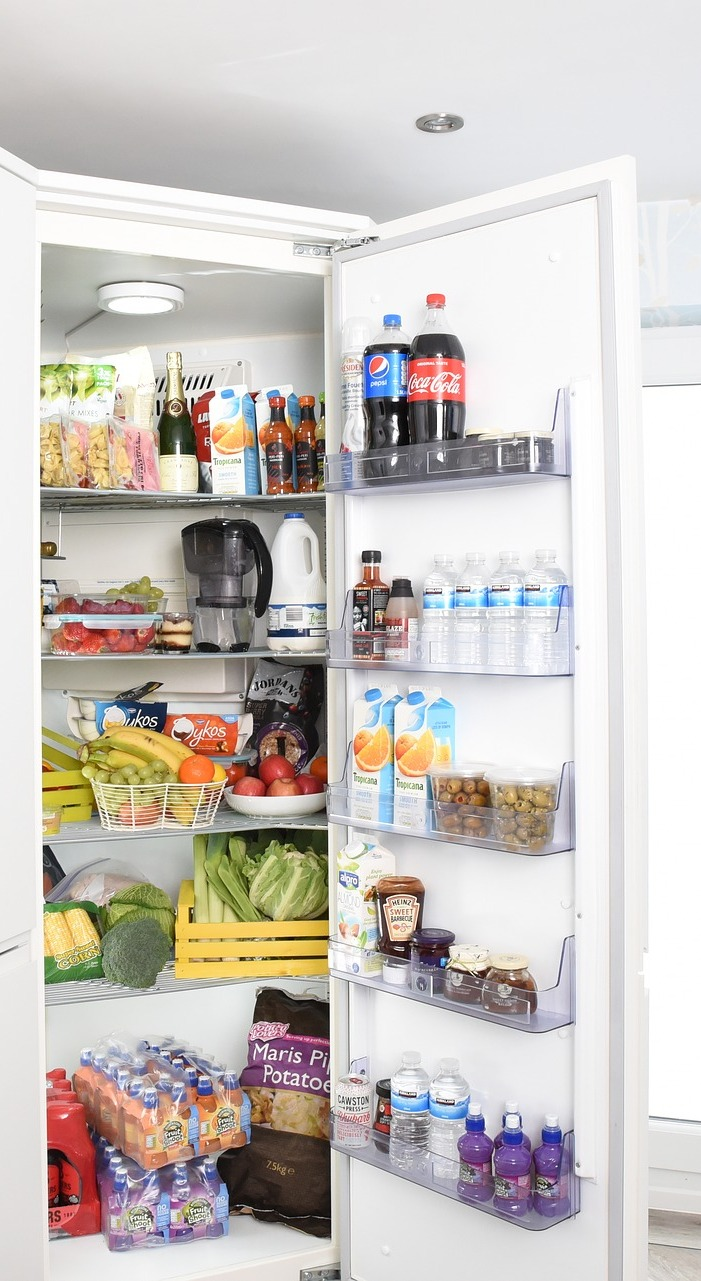 Fridge with food items.