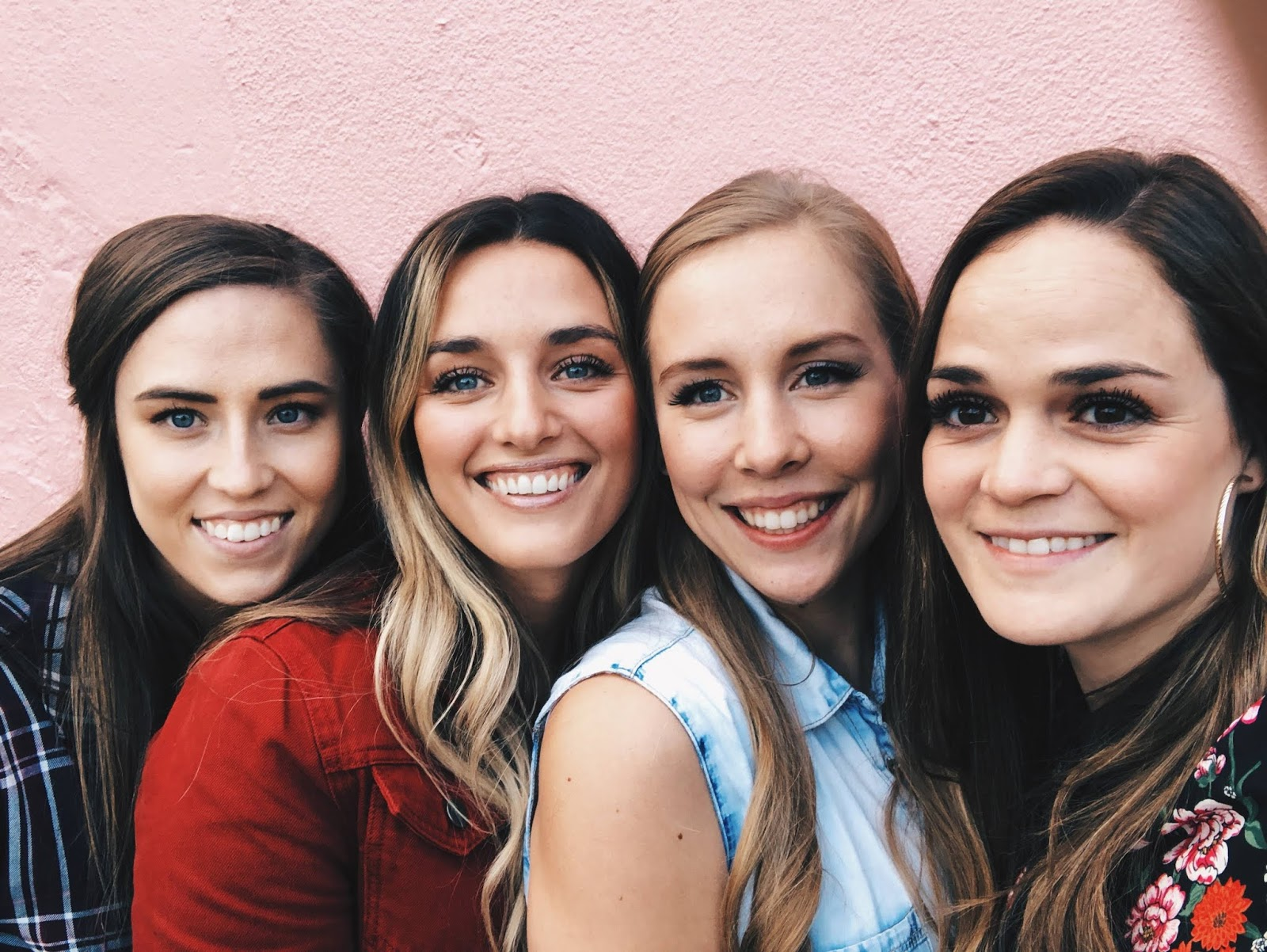 four girl friends smiling in Charleston, SC