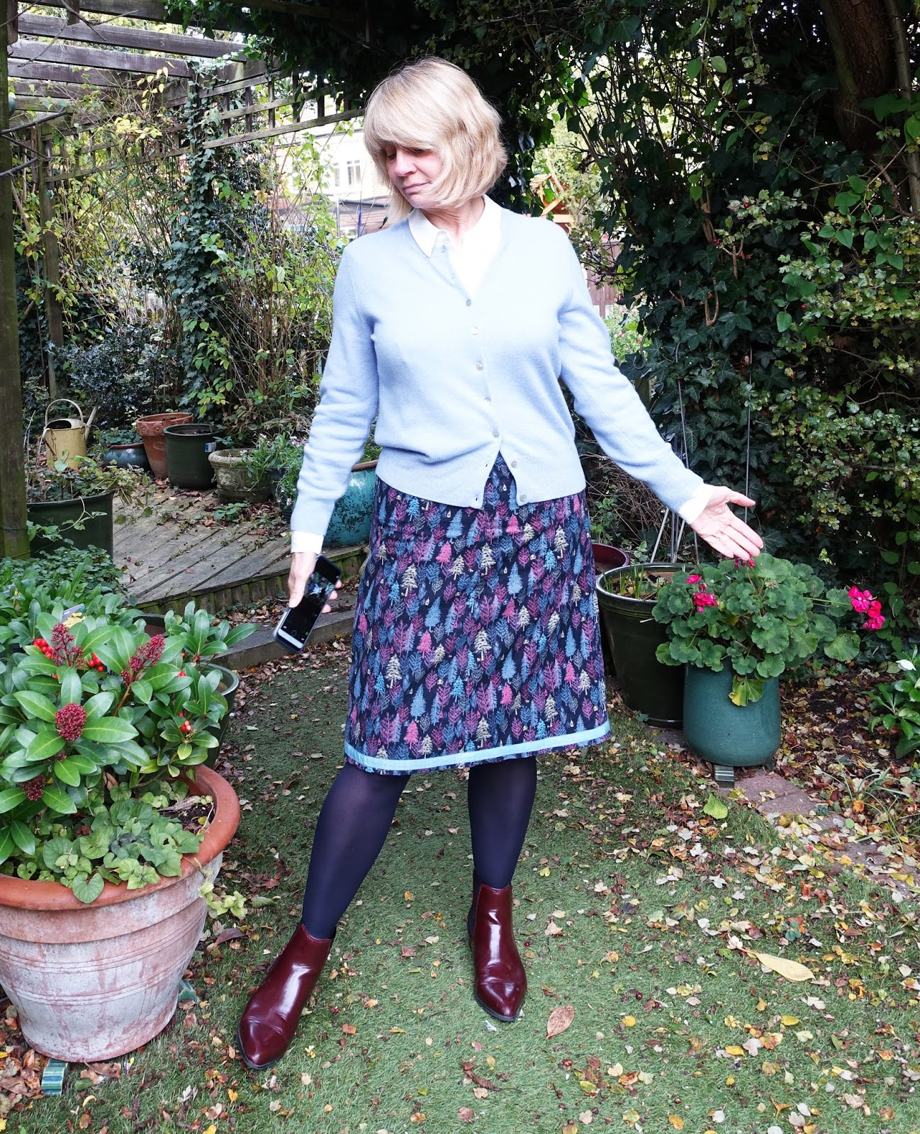 Over 50s fashion blogger Gail Hanlon shows a boring outfit which makes her look frumpy. By adding three accessories she improves the line and feel