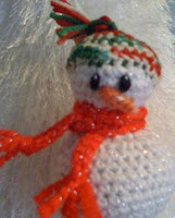 http://www.ravelry.com/patterns/library/shivers-the-snowman-ornament