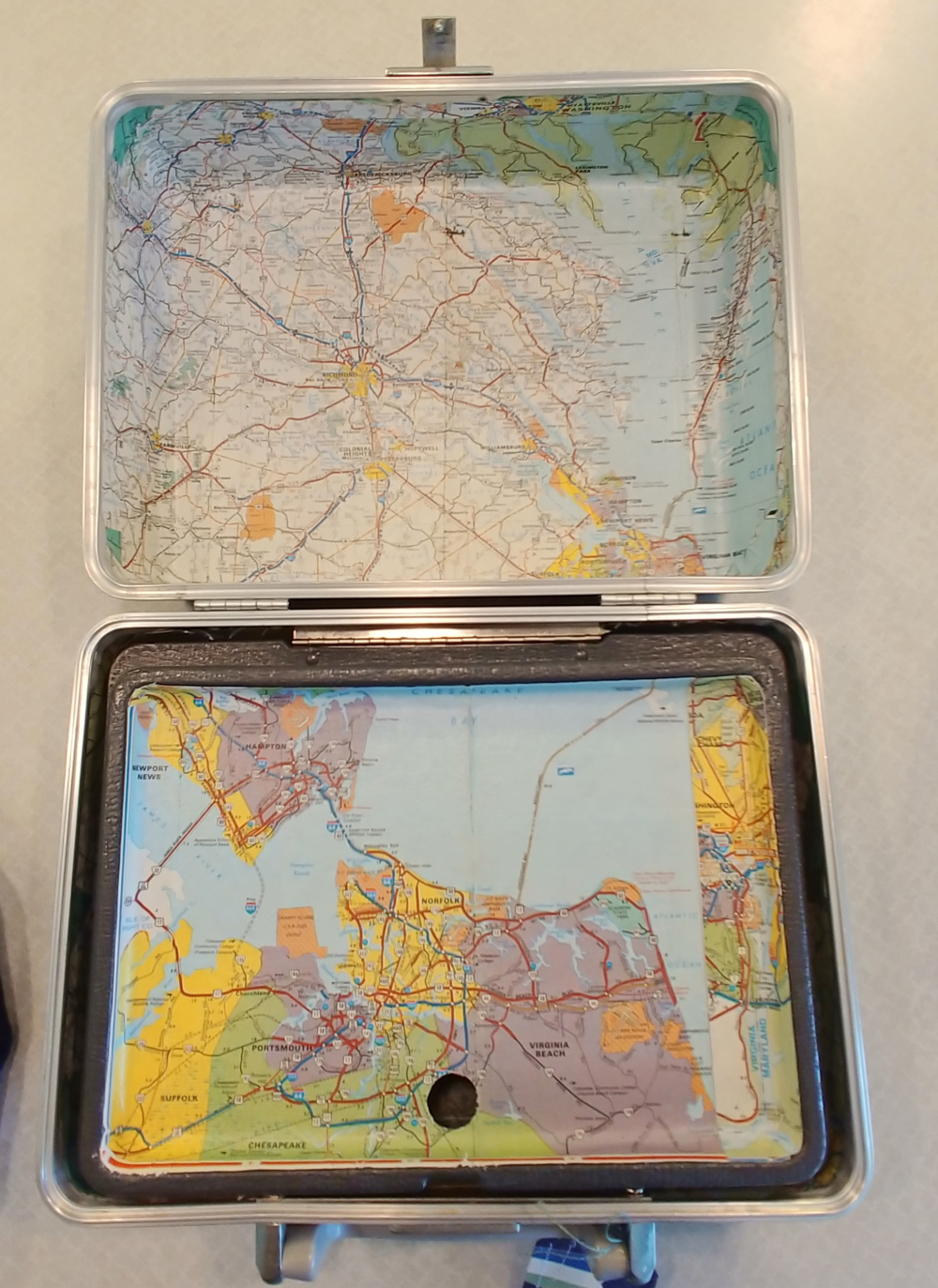 map lined suitcase