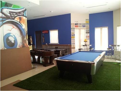 A game room with a billiards table and table soccer