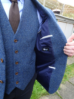 inside pocket of tweed jacket silk lined