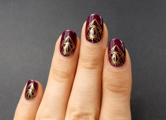 Red and gold nail art design
