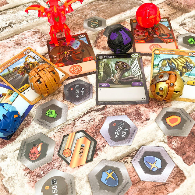 Picture of the Bakugan transforming toy and the cards that come with it