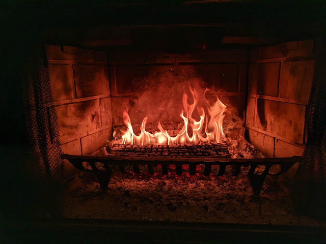 Log on fire in a fireplace