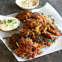 Battered and fried onion fritters