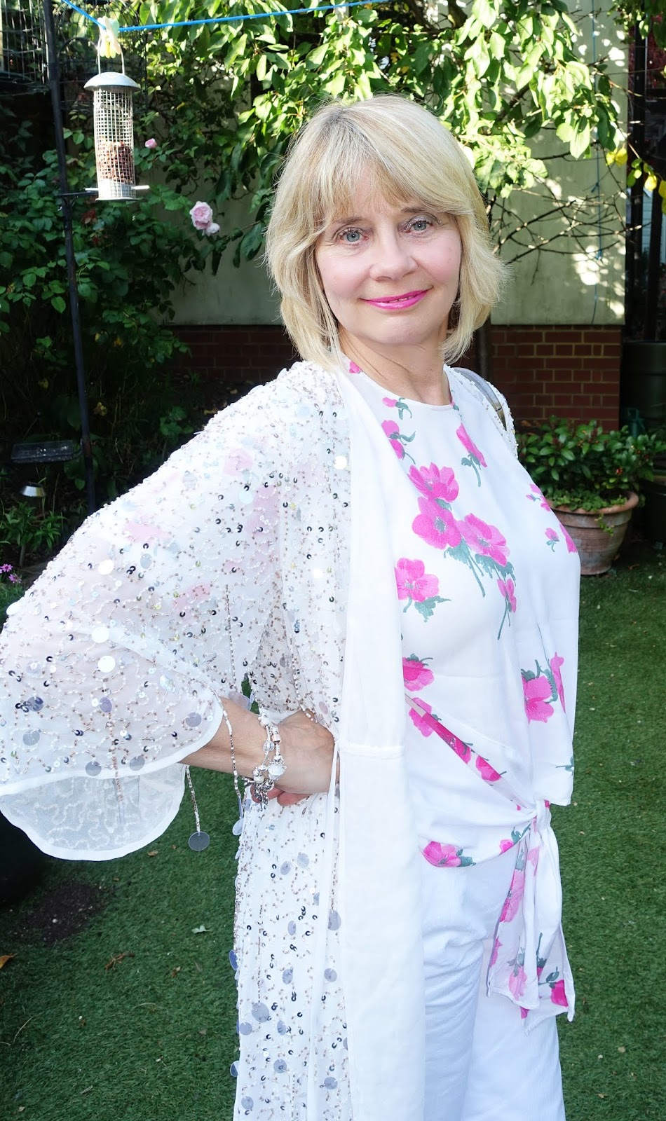 A white cat glistening with bugle beads and sequins worn by over-50s blogger Gail Hanlon from Is This Mutton?