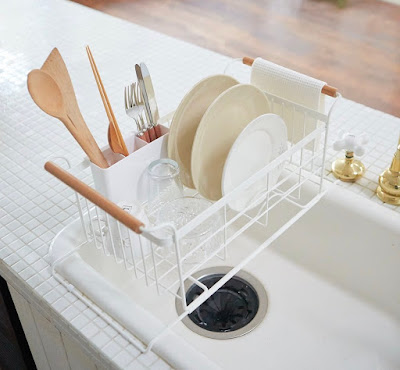 dish rack that rests over the sides of the sink, with the rack rising up  above the sink