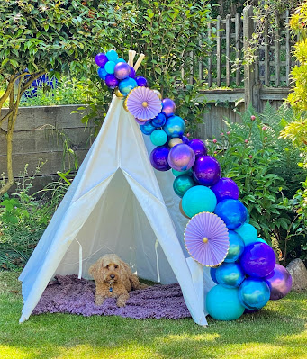 Fantastic mermaid coloured balloons have been used to decorate this children's teepee