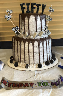 Two-Tiered Cake With 50 at the Top