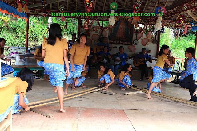 Pinoy kids performing tinikling, Loboc River, Bohol, Philippines