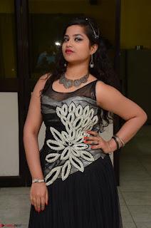 Shrisha Dasari in Sleeveless Short Black Dress At Follow Follow U Audio Launch 031.JPG