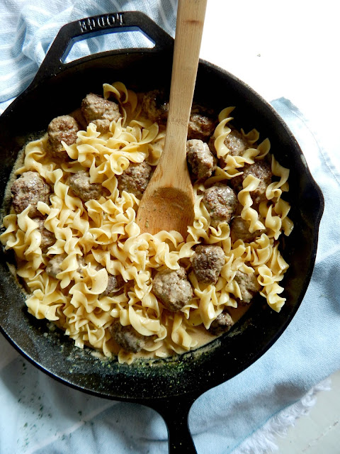 Classic Swedish Meatballs...this fun, family-friendly dinner comes together is just over 30 minutes!  Tender, flavor-filled meatballs in a homemade cream gravy, served over egg noodles.  Comfort food at its finest! (sweetandsavoryfood.com)