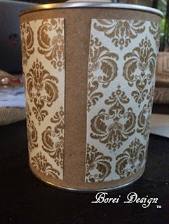 Adding paper panels to can.