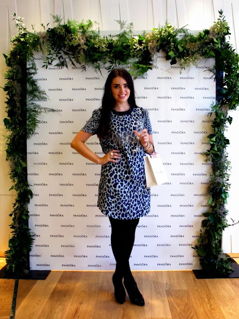 Emma Louise Layla wearing leopard print Maison Scotch dress at the Pandora Oxford Street flagship store launch event