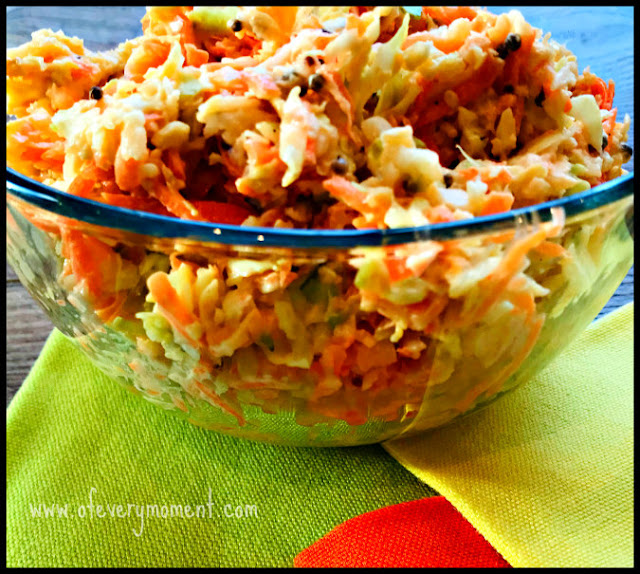 Bowl of coleslaw resting on tri-colored napkins