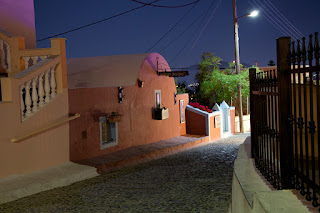 Colorful architecture in the town of Firastefani, Santorini Greece at night