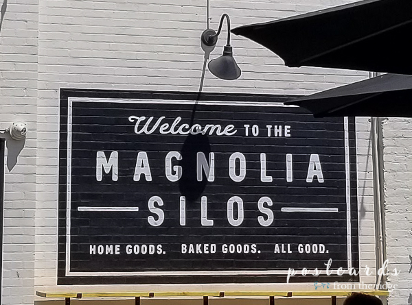 magnolia silos black and white sign painted on brick wall