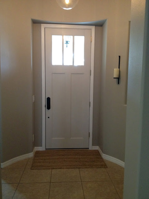 Cumulus Cloud by Benjamin Moore with Classic Grey craftsman door