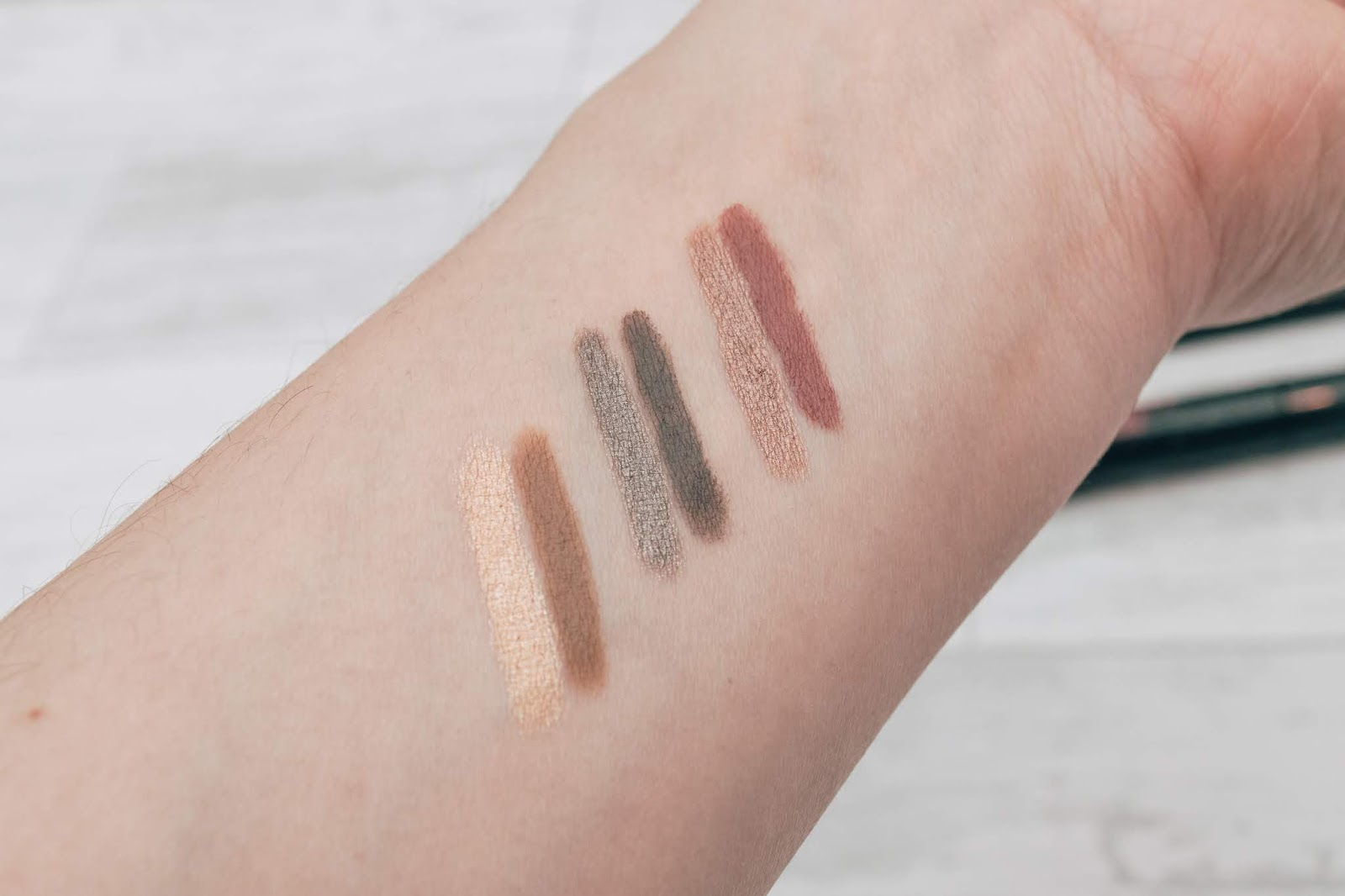 Swatches of eye shadow colours on a wrist
