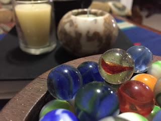 A close-up of my father's marbles in a bowl he made in high school