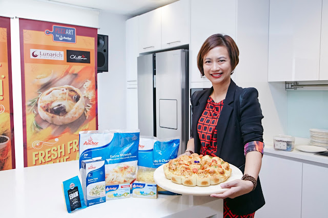 Ms Linda Tan, Director of Anchor Food Professionals showcases the artisanal Flower Pizza and the range of Anchor Products used to prepare it for the launch of Anchor Food Professionals' PizzArt Campaign launch