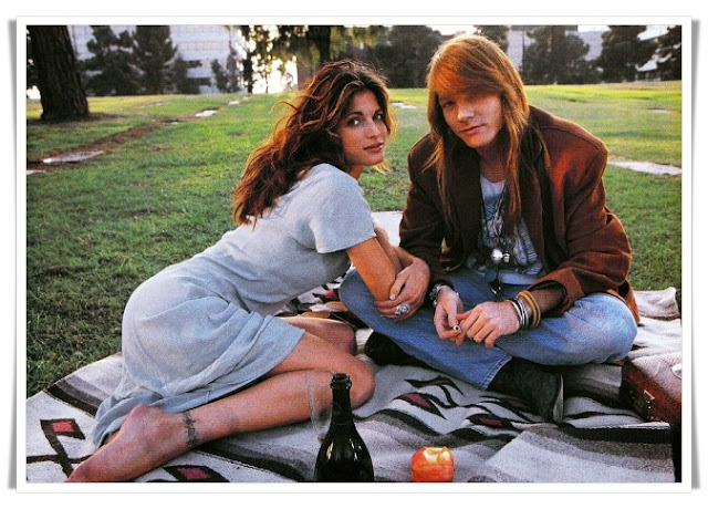 Axl Rose and Stephanie Seymour having a picnic in a cemetery during the Don't Cry video shoot. PunkMetalRap.com