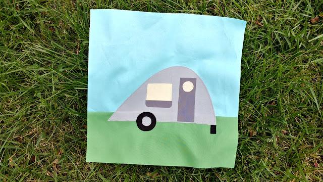 Teardrop camper quilt block using raw-edge applique and solid fabrics