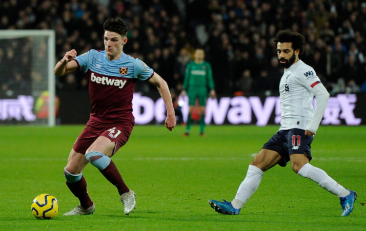 Declan Rice distributing the ball against Liverpool