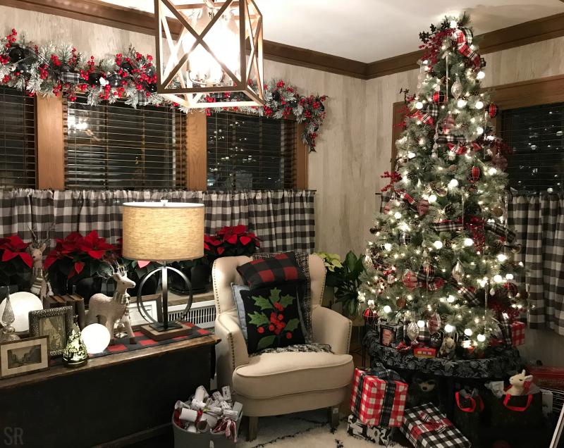 a living room with Buffalo plaid Christmas decorations