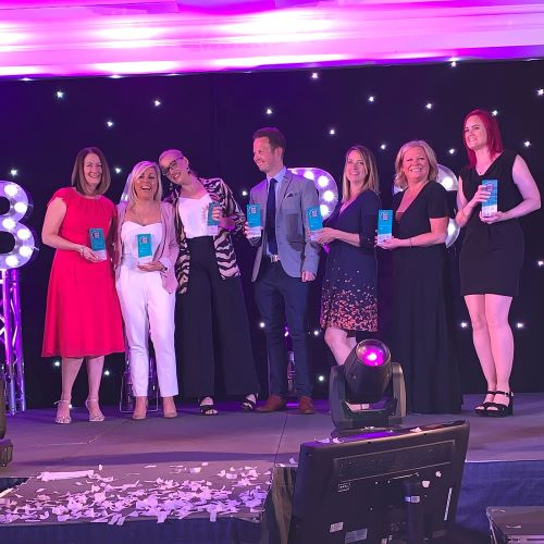 BAPS awards winners posing on stage